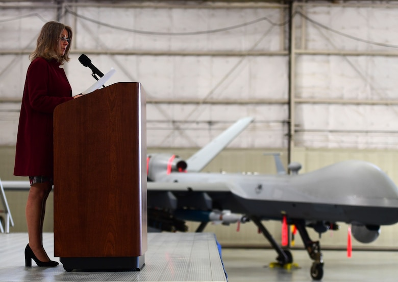 "Ms. Jonna Doolittle Hoppes, executive director of the Doolittle Foundation and granddaughter of Gen. James ""Jimmy"" Doolittle, speaks to the men and women of the 432nd Wing/432nd Air Expeditionary Wing Jan. 18, 2018, at Creech Air Force Base, Nev. Doolittle Hoppes and retired Lt. Gen. Christopher Miller, president of the Air Force Historical Foundation, presented the General James H. ""Jimmy"" Doolittle award to the 432nd Wing/432nd Air Expeditionary Wing for making a significant impact to Air Force history. (U.S. Air Force photo/Senior Airman Christian Clausen)"