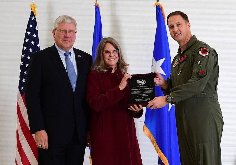 "Ms. Jonna Doolittle Hoppes, executive director of the Doolittle Foundation and granddaughter of Gen. James ""Jimmy"" Doolittle, and retired Lt. Gen. Christopher Miller, president of the Air Force Historical Foundation, present the General James H. ""Jimmy"" Doolittle award to Col. Julian Cheater on behalf of the 432nd Wing/432nd Air Expeditionary Wing Jan. 18, 2018, at Creech Air Force Base, Nev. The General James H. ""Jimmy"" Doolittle award is presented to units who display gallantry, determination, espirit de corps and superior management of joint operations in accomplishing its mission under difficult and hazardous conditions in multiple conflicts. (U.S. Air Force photo/Senior Airman Christian Clausen)"