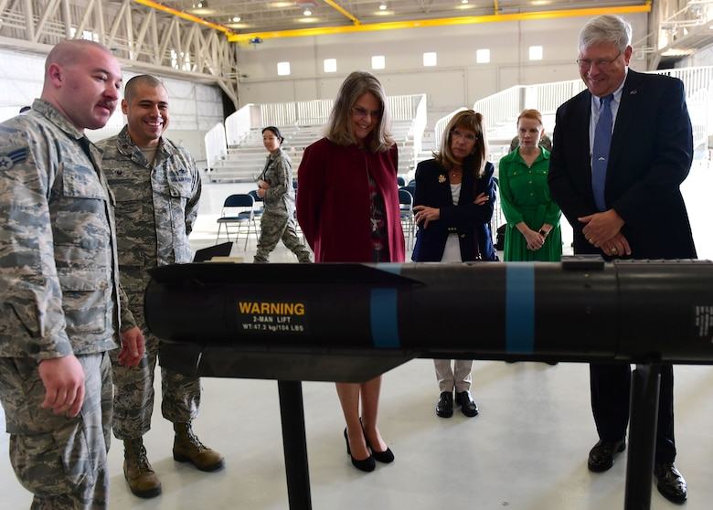 "Ms. Jonna Doolittle Hoppes, executive director of the Doolittle Foundation and granddaughter of Gen. James ""Jimmy"" Doolittle, and retired Lt. Gen. Christopher Miller, president of the Air Force Historical Foundation, look at the inner workings of an AGM-114 Hellfire missile Jan. 18, 2018. During their visit, Doolittle Hoppes and Miller received an in depth look at the Remotely Piloted Aircraft mission before presenting the General James H. ""Jimmy"" Doolittle award to the 432nd Wing/432nd Air Expeditionary Wing. (U.S. Air Force photo/Senior Airman Christian Clausen)"