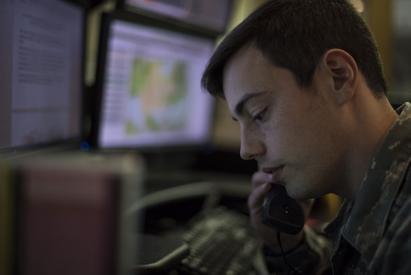 Airman 1st Class Kolton McCasland, 27th Special Operations Support Squadron weather apprentice, answers a phone call at Cannon Air Force Base, N.M., Jan. 24, 2017. Part of a weather forecaster's job is to communicate with leadership and pilots across base to ensure constant mission readiness. (U.S. Air Force photo by Senior Airman Lane T. Plummer)
