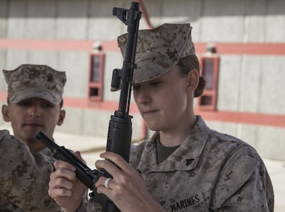 Cpl. Madeline Engle, a radio operator with Task Force Al-Taqaddum 18.1 Rotation 6, assembles an AK-47 assault rifle during a foreign weapons demonstration at Marine Corps Base Camp Pendleton, California, Jan. 16, 2018.