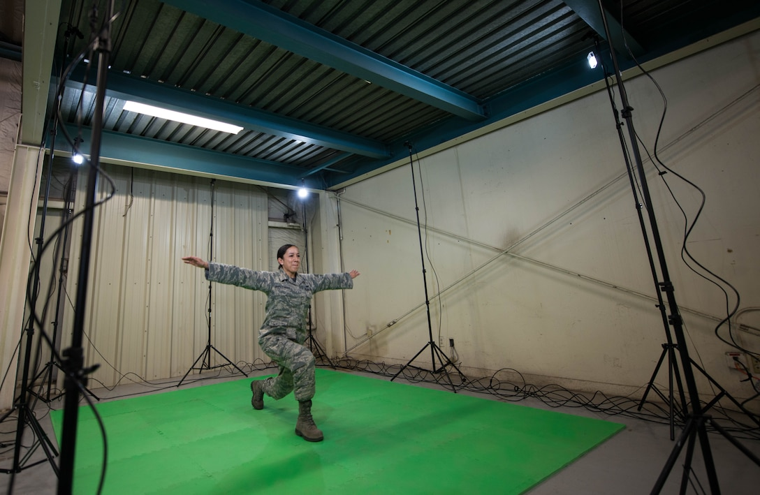 Staff Sgt. Jennifer Oropeza-Magee, 56th Aerospace Medical Squadron flight medical technician, performs movements during a Dynamic Athletic Research Institute assessment at Luke Air Force Base, Ariz., Jan. 26, 2018. The assessment was conducted using the DARI marker-less motion analytics machine, an eight camera system designed to pinpoint weak muscle groups and predict which areas of the body are most prone to injury. (U.S. Air Force photo/Airman 1st Class Alexander Cook)