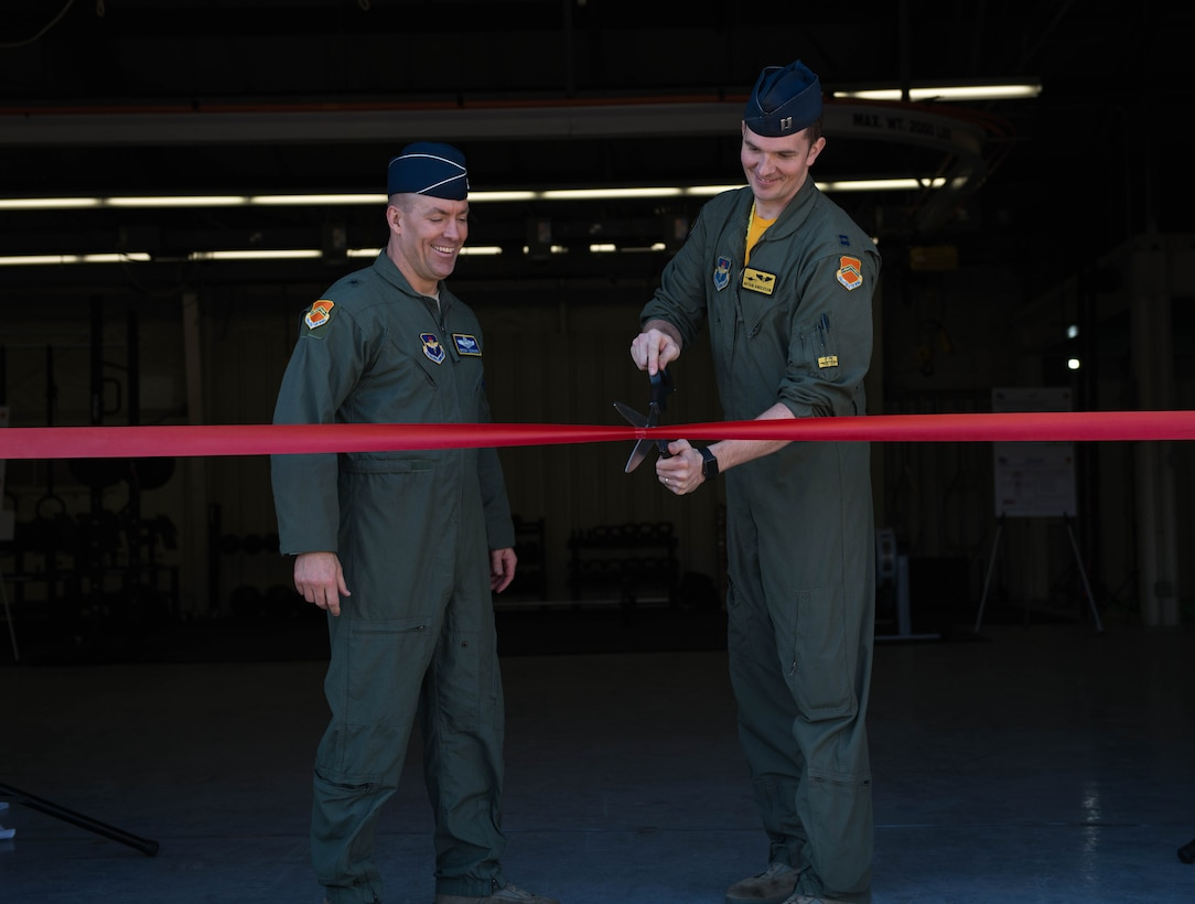 Brig. Gen. Brook Leonard, 56th Fighter Wing commander and Capt. Bryan Anderson, 56th Medical Group flight surgeon, cut the ribbon to the Aviator Center of Excellence at Luke Air Force Base, Ariz., Jan. 26, 2018. The ACE is a new, high-performance athletic training facility for pilots offering one-on-one coaching, individualized fitness plans and fitness equipment. (U.S. Air Force photo/Airman 1st Class Alexander Cook)