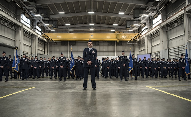 Col. Lloyd Buzzell, 20th Air Force vice commander, leads a formation comprised of 20th Air Force Airmen during a change of command ceremony at F.E. Warren Air Force Base, Wyo., Jan. 26, 2018. The formation represented the Airmen across 20th Air Force within each of the four wings. The 20th Air Force mission is to prepare the nation's ICBM force to execute safe, secure and effective nuclear strike operations and to support worldwide combat command requirements. (U.S. Air Force photo by Airman 1st Class Abbigayle Wagner)