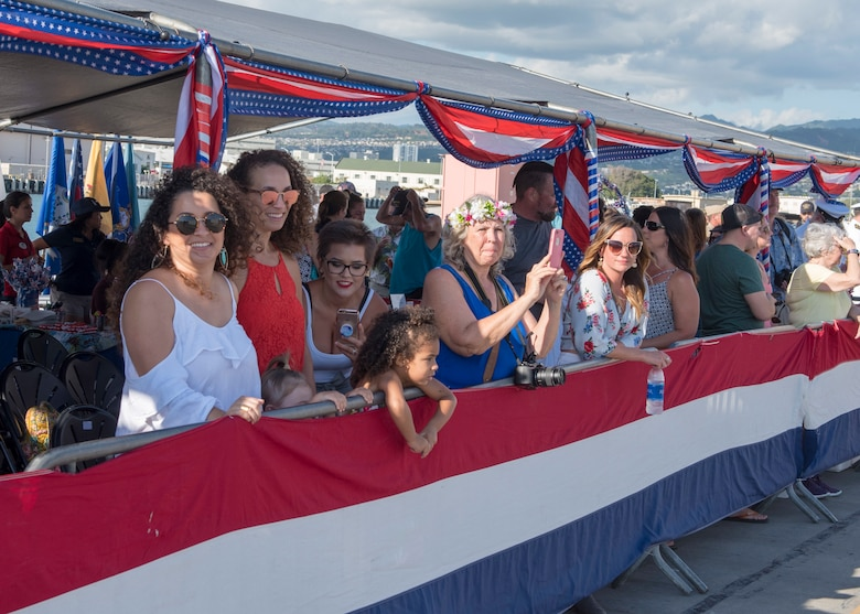 180126-N-KV911-0051 PEARL HARBOR (Jan. 26, 2018) Family members wait for their loved ones from the Virginia-class fast-attack submarine USS Missouri (SSN 780) to arrive at Joint Base Pearl Harbor-Hickam following a change of homeport from Groton, Connecticut, Jan. 26. USS Missouri is the 6th Virginia-class submarine homeported in Pearl Harbor. (U.S. Navy Photo by Mass Communication Specialist 2nd Class Shaun Griffin/Released)