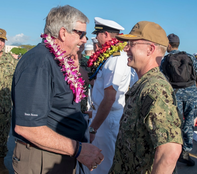 180126-N-KV911-0166 PEARL HARBOR (Jan. 26, 2018) Missouri Lieutenant Governor Michael L. Parson speaks with Rear Adm. Daryl Caudle, commander, Submarine Force, U.S. Pacific Fleet following the Virginia-class fast-attack submarine USS Missouri (SSN 780) arrival at Joint Base Pearl Harbor-Hickam following a change of homeport from Groton, Connecticut, Jan. 26. USS Missouri is the 6th Virginia-class submarine homeported in Pearl Harbor. (U.S. Navy Photo by Mass Communication Specialist 2nd Class Shaun Griffin/Released)
