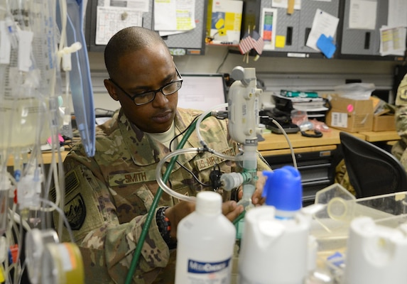 Tech. Sgt. Richard Smith, 455th Expeditionary Medical Operation Squadron clinical engineering NCOIC, repairs medical equipment Jan. 15, 2018 at Craig Joint Theater Hospital in Bagram Airfield, Afghanistan.
