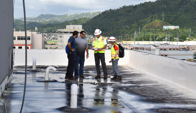 Members of the U.S. Army Corps of Engineers' Critical Public Facilities team in Puerto Rico meet with contractors who are doing temporary roofing repairs to critical facilities throughout the island. The Critical Public Facilities team is focused on making temporary roof repairs to buildings like police stations, fire stations, and hospitals to get these services back online faster post-Hurricane Maria.