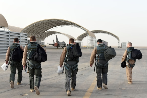 100th Expeditionary Fighter Squadron pilots walk to their F-16 Fight Falcons before returning home at an undisclosed location in Southwest Asia, Jan. 20, 2018. These pilots contributed to dropping 105 bombs in the fight against ISIS. (U.S. Air Force photo by Staff Sgt. Joshua Edwards/Released)