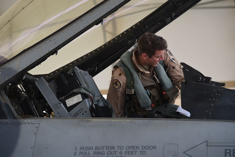 A 100th Expeditionary Fighter Squadron pilot checks his cockpit before a flight at an undisclosed location in Southwest Asia, Jan. 20, 2018. This was one of the final steps for the pilot before returning home from his deployment. (U.S. Air Force photo by Staff Sgt. Joshua Edwards/Released)