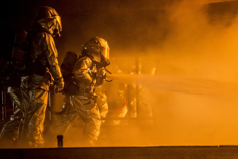 Aircraft Rescue and Firefighting Marines extinguish a jet fuel training aboard Marine Corps Air Station Beaufort, Jan 19. The Marines are with Headquarters and Headquarters Squadron.