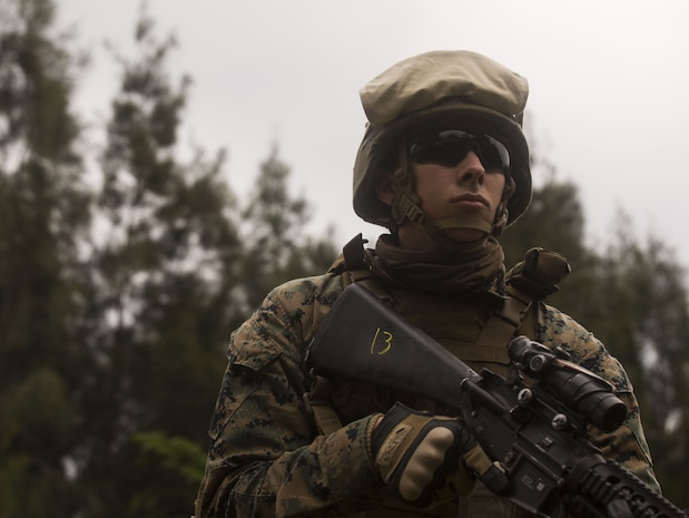 U.S. Marine Lance Cpl. Nathon Peterson provides security during Exercise Samurai Jan. 23, 2018, on Camp Hansen, Okinawa, Japan. Marines with Headquarters Battalion, 3rd Marine Division trained to refine their skills for Division operations in an expeditionary environment. Peterson, a native of Hamilton, Montana, supported the exercise as a rifleman in a provisional rifle platoon.