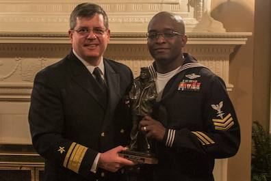 Commander of Navy Reserve Forces Command, Rear Adm. Thomas Lusher, announced Hospital Corpsman 1st Class Cedrick Jenkins as the 2017 Navy Reserve Full Time Support Shore Sailor of Year during a ceremony held at the Maryland House on Naval Station Norfolk, Jan. 11, 2018.