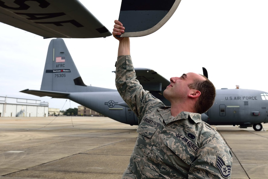 Staff Sgt. Patrick Gaudet, 403rd Aircraft Maintenance Squadron dedicated crew chief, inspects the propeller blade of a WC-130J Super Hercules aircraft to make sure there are no cracks or other damage Jan. 26, 2018, at Keesler Air Force Base, Mississippi. Crew chiefs are responsible for performing numerous checks, tests and maintenance on aircraft to make sure the Air Force fleet is fit for flight. (U.S. Air Force photo by Tech. Sgt. Ryan Labadens)