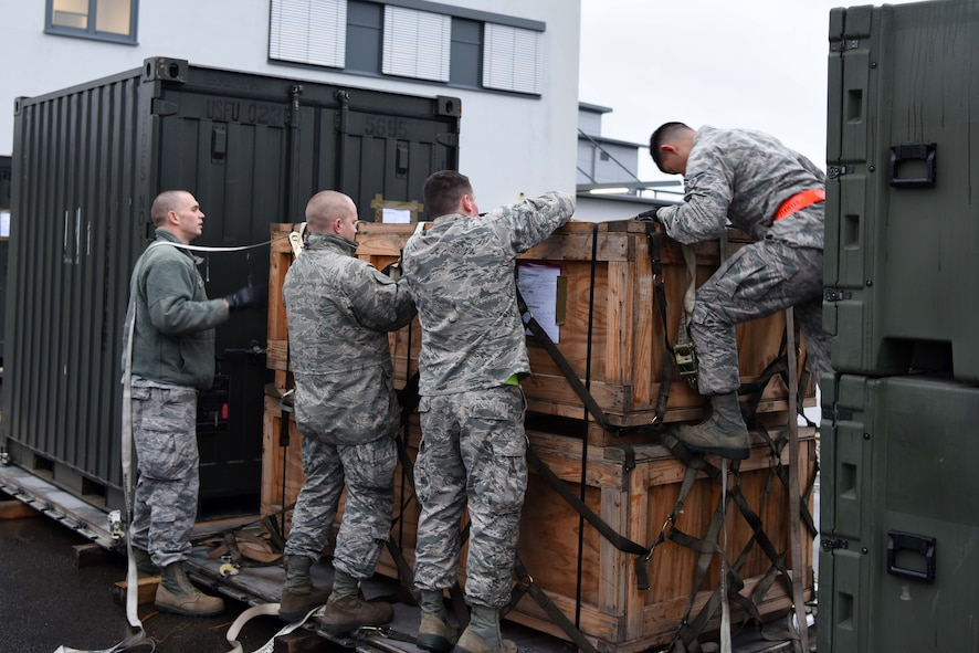 U.S. Airmen assigned to the 86th Logistics Readiness Group participate in a mobility exercise on Ramstein Air Base, Germany Jan. 26, 2018. The Airman practiced securing a pallet on a cargo plane.