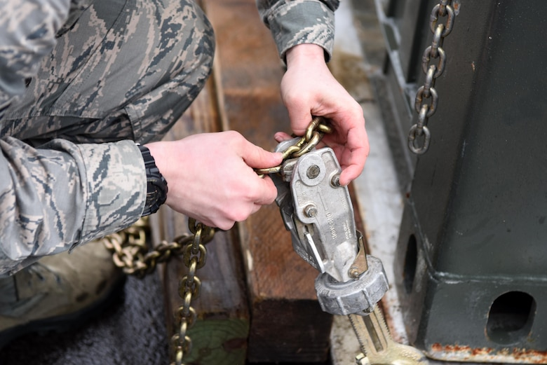 A U.S. Airman assigned to the 86th Logistics Readiness Group secures a chain to lock a pallet in place as part of a mobility exercise on Ramstein Air Base, Germany Jan. 26, 2018. Exercises like this are scheduled to be performed twice a year with eventual inclusion of other units besides the 86th Airlift Wing.