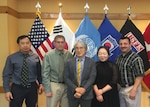 Kyu Sok Kwak (center) was recognized as the 2017 United States Forces Korea Civilian Employee of the Year