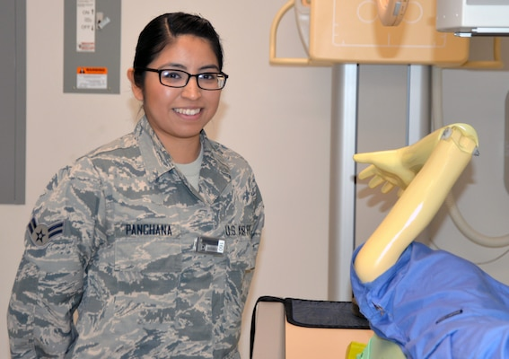 Air Force Airman 1st Class Gisella Panchana poses in the radiology laboratory at the Medical Education and Training Campus at Joint Base San Antonio-Fort Sam Houston. She is set to graduate from the METC radiology program Jan. 30 and will continue her training as a radiology technician at Travis Air Force Base, Calif.