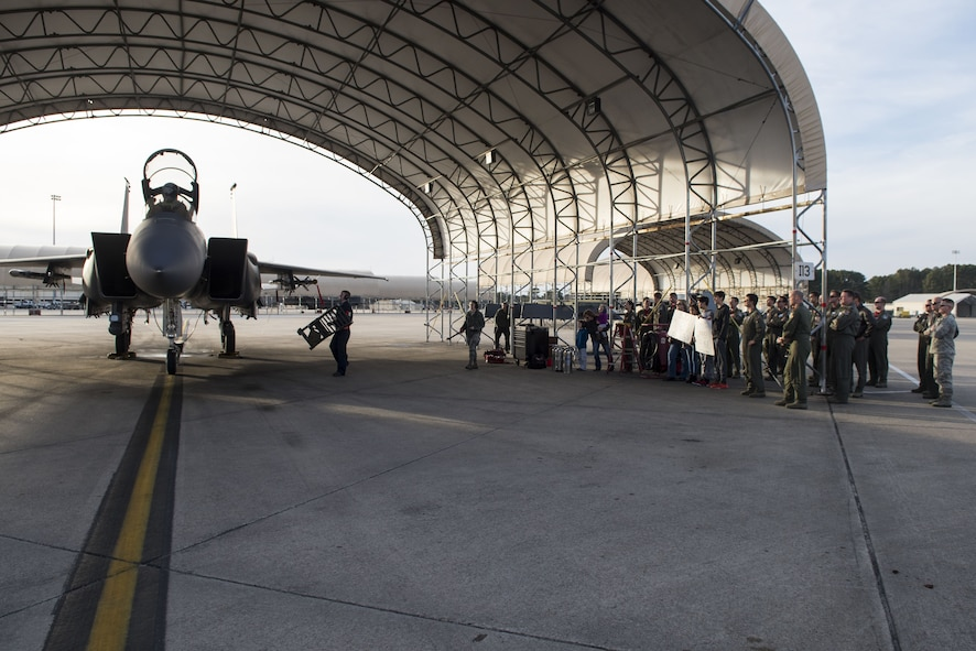 Family and friends of Lt. Col. Eric Ostendorf, 307th Fighter Squadron assistant director of operations, wait for him to exit an F-15E Strike Eagle, Jan. 26, 2018, at Seymour Johnson Air Force Base, North Carolina.