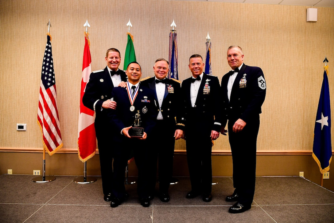 American Lake Conference Center on Joint Base Lewis-McChord, Washington, Jan. 27, 2018.  Rivera was awarded the trophy for his outstanding contributions to the Washington Air National Guard over the last year.  Pictured from left to right are: Gen. Robin Rand, Air Force Global Strike Command and Air Forces Strategic-Air, U.S. Strategic Command commander, Rivera, Maj. Gen. Bret Daugherty, Adjutant General of the Washington National Guard, Montgomery, Brig. Gen. Jeremy Horn, commander of the Washington Air National Guard, River, and Chief Master Sgt. Max Tidwell, Washington Air National Guard command chief. (U.S. Air National Guard photo by Tech. Sgt. Timothy Chacon)