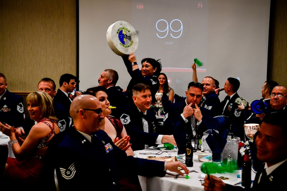 Members of the Western Air Defense Sector cheer for thier award nominees during the Washington Air National Guard's 9th Annual Awards Banquet held Jan. 27, 2018, at the American Lake Conference Center on Joint Base Lewis-McChord, Washington.  (U.S. Air National Guard Photo by Tech. Sgt. Timothy Chacon)