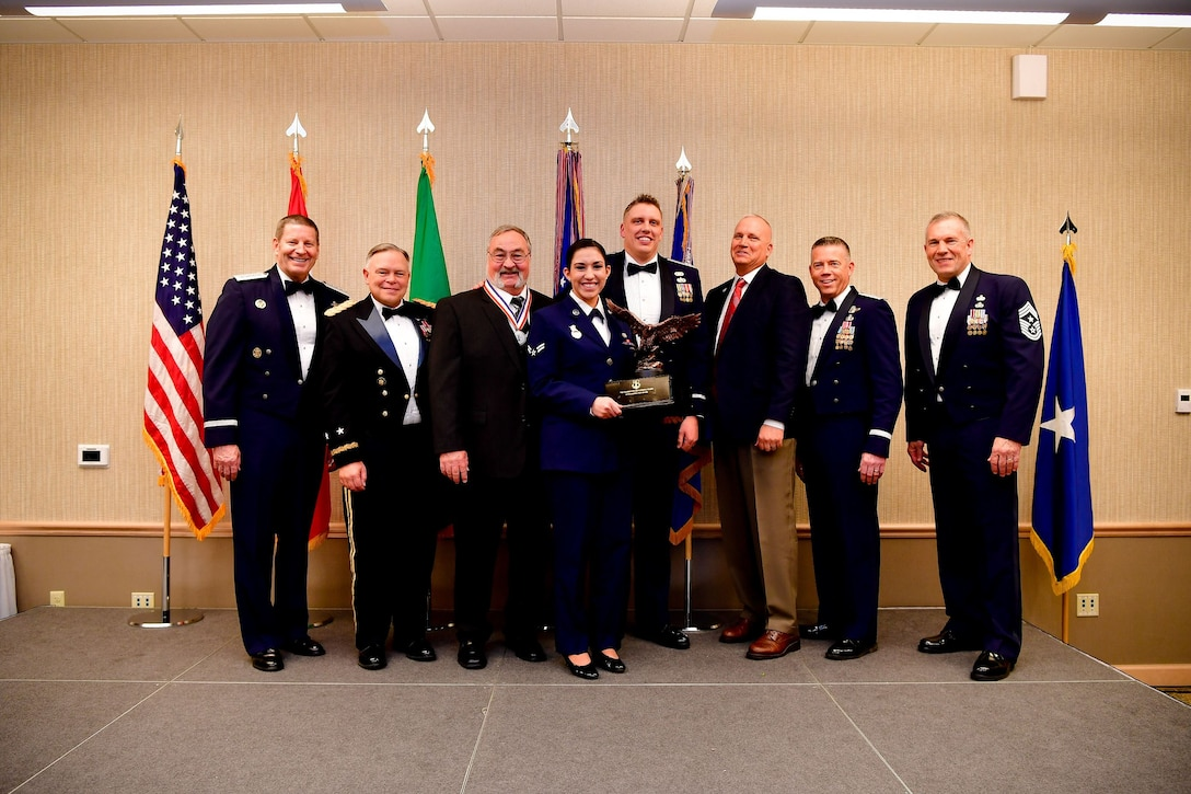The Washington Air National Guard Squadron of the Year is awarded to the 141st Security Forces Squadron, 141st Air Refueling Wing.  Members of the 141st SFS pose for a picture during the Washington Air National Guard's 9th Annual Awards Banquet held at the American Lake Conference Center on Joint Base Lewis-McChord, Washington, Jan. 27, 2018.  (U.S. Air National Guard Photo by Tech. Sgt. Timothy Chacon)