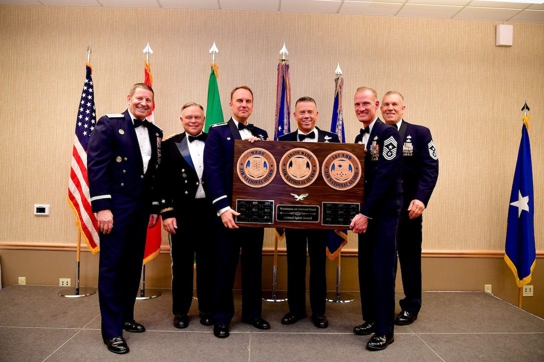 The 141st Air Refueling Wing commander, Col. Johan Deutscher, accepts the unit spirit award during the Washington Air National Guard's 9th Annual Awards Banquet held at the American Lake Conferenc Center on Joint Base Lewis-McChord, Washington, Jan. 27, 2018. Pictured from left are: Gen. Robin Rand, Air Force Global Strike Command and Air Forces Strategic-Air, U.S. Strategic Command commander; Maj. Gen. Bret Daugherty, Adjutant General of the Washington National Guard, Col. Johan Deutscher, 141st ARW commander, Brig. Gen. Jeremy Horn, commander of the Washington Air National Guard, Chief Master Sgt. Dave Bishop, 141st ARW command chief, and Chief Master Sgt. Max Tidwell, WA ANG command chief. (U.S. Air National Guard Photo by Tech. Sgt. Timothy Chacon)