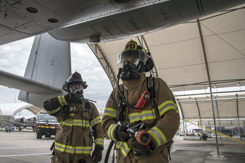 Firefighters from the 23d Civil Engineer Squadron (CES) inspect the wing of an A-10C Thunderbolt II, Jan.24, 2018, at Moody Air Force Base, Ga. Firefighters from the 23d CES conducted A-10C Thunderbolt II extraction training to practice extinguishing an aircraft fire and quickly rescuing a pilot from an A-10. The 23d CES holds the extraction training twice annually and are evaluated on the amount of time it takes them to rescue a pilot from the cockpit. (U.S. Air Force photo by Airman Eugene Oliver)