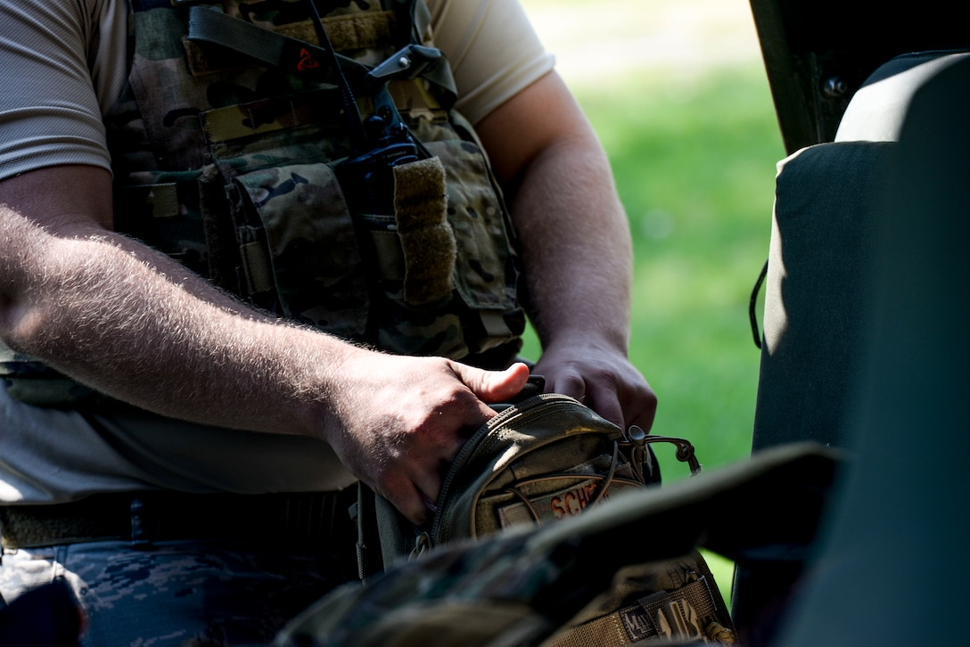 Staff Sgt. Nicholas Scheer, 788th Civil Engineer Squadron, explosive ordinance disposal technician, grabs his recon backpack from the truck after arriving on scene of an unexploded ordinance scenario during an exercise at Wright-Patterson Air Force Base, Ohio Aug. 2016. The 88th Air Base Wing routinely conducts readiness exercises to test and enhance the skills and proficiency of units on base.