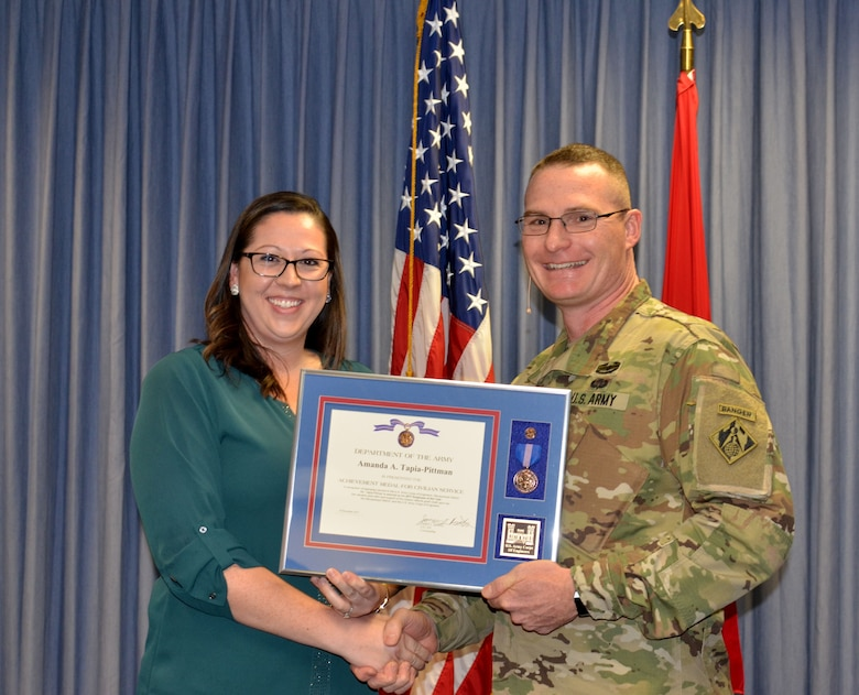 ALBUQUERQUE, N.M. – District commander Lt. Col. James Booth recognizes Amanda Tapia-Pittman as the District's Employee of the Year during the District's 2017 Annual Award Presentations, Dec. 8, 2017.