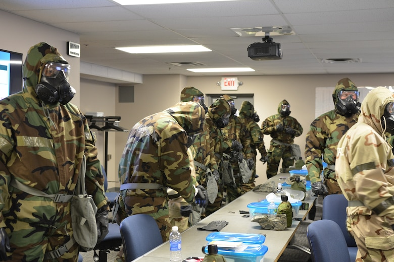 Members complete weapons qualifications in preparation for deployment at the Combat Arms Training and Maintenance facility at the 88th Security Forces Squadron on Wright-Patterson Air Force Base. (Air Force/contributed photo)