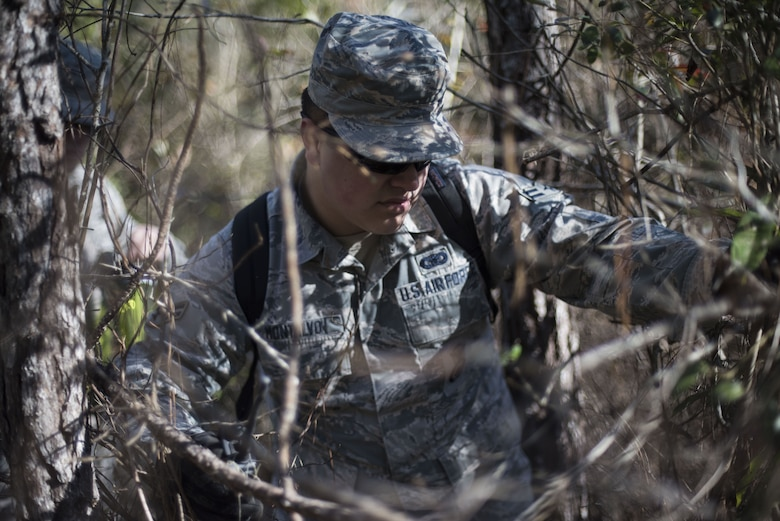 Airman 1st Class Anthony Montalvo, 824th Base Defense Squadron fireteam member, traverses through the woods while scanning for signs of an improvised explosive device (IED) during training, Jan. 24, 2018, at Moody Air Force Base, Ga. The 820th Base Defense Group defenders trained on how to detect IEDs and counter measures to take when one is found. IEDs have become one of the most common forms of attack in the Middle East since 2003. (U.S. Air Force photos by Staff Sgt. Eric Summers Jr.)