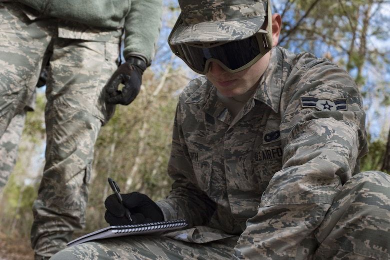 Airman 1st Class Kevin Smith, 824th Defense Squadron fireteam member, records a nine-line report to pass along information of a simulated improvised explosive device during training Jan. 24, 2018, at Moody Air Force Base, Ga. The 820th Base Defense Group defenders trained on how to detect IEDs and counter measures to take when one is found. IEDs have become one of the most common forms of attack in the Middle East since 2003. (U.S. Air Force photos by Staff Sgt. Eric Summers Jr.)