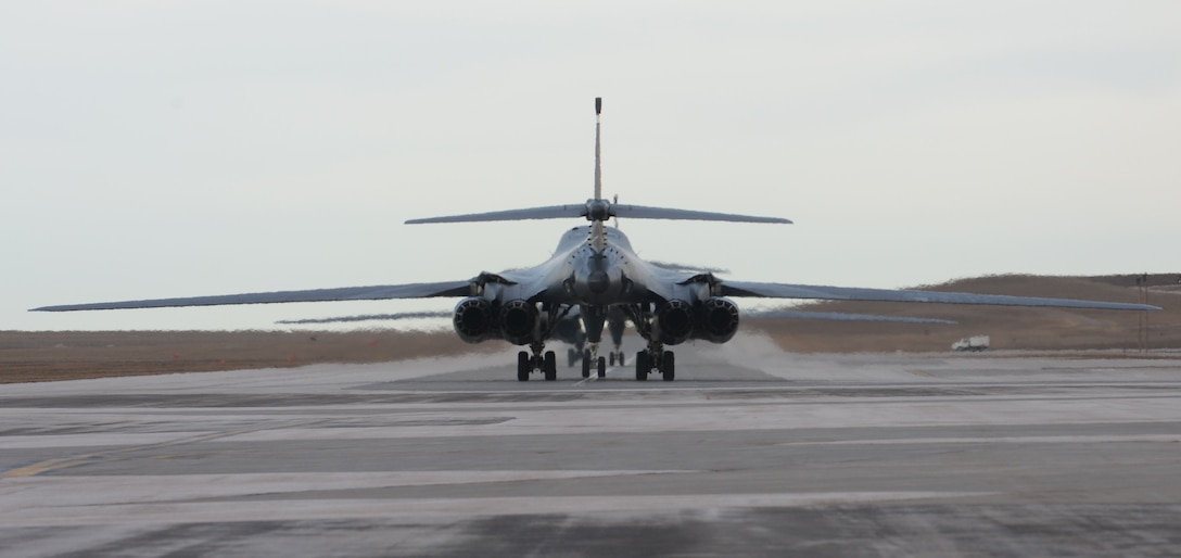 B-1 bombers returning from Andersen Air Force Base, Guam, taxi down the runway at Ellsworth Air Force Base, S.D., Jan. 25, 2018. B-1 bombers from the 37th Bomb Squadron and Airmen from the 37th Aircraft Maintenance Unit were deployed to Andersen AFB, to take part in the Continuous Bomber Presence mission. (U.S. Air Force photo by Airman 1st Class Nicolas Z. Erwin)