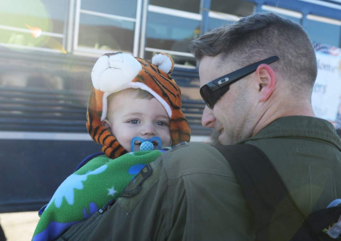 Capt. Chad, a weapons system officer assigned to the 37th Bomb Squadron, holds his son, Grant, at Ellsworth Air Force Base, S.D., Jan. 25, 2018, after returning from a six-month deployment. B-1 bomber aircrews conducted sorties close to South Korea's northern border as part of the U.S. Pacific Command's Continuous Bomber Presence mission. (U.S. Air Force photo by Airman 1st Class Thomas Karol)
