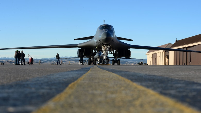 A B-1 bomber assigned to the 37th Bomb Squadron is checked over by maintenance personnel at Ellsworth Air Force Base, S.D., Jan. 24, 2018. B-1 bombers from the 37th BS were deployed to Andersen AFB, Guam, to take part in the Continuous Bomber Presence mission. (U.S. Air Force photo by Airman 1st Class Donald Knechtel)
