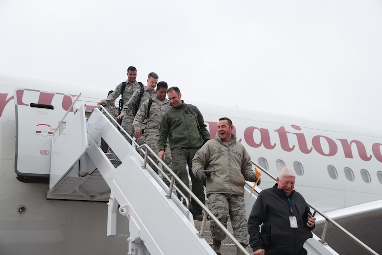 Airmen assigned to the 37th Bomb Squadron and the 28th Aircraft Maintenance Squadron return to Ellsworth Air Force Base, S.D., Jan. 29, 2018, after a six-month deployment to Andersen AFB, Guam. B-1 bombers from the 37th BS and Airmen from the 37th Aircraft Maintenance Unit were deployed to Andersen AFB to take part in the Continuous Bomber Presence mission being conducted by the U.S. Pacific Command. (U.S. Air Force photo by Airman 1st Class Donald Knechtel)