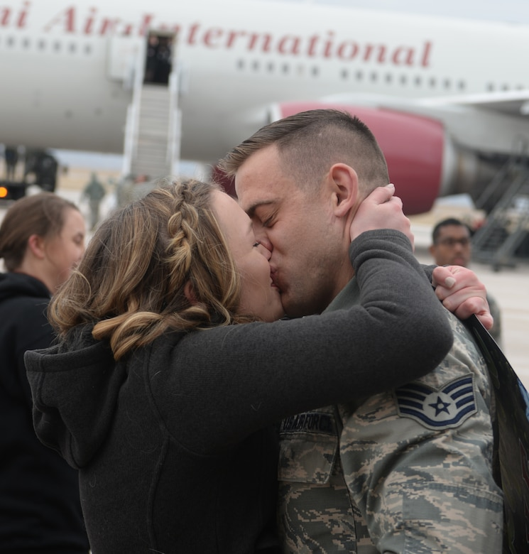 Staff Sgt. Gabriel Henry, a crew chief assigned to the 28th Aircraft Maintenance Squadron, is greeted on the flight line at Ellsworth Air Force Base, S.D., Jan. 29, 2018, after returning from a six-month deployment to Andersen AFB, Guam. B-1 bombers from the 37th Bomb Squadron and Airmen from the 37th Aircraft Maintenance Unit were deployed to Anderson AFB to take part in the Continuous Bomber Presence mission. (U.S. Air Force photo by Airman 1st Class Thomas Karol)
