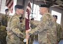 Col. Theodore Brown, left, receives the hospital colors from Maj. Gen. Thomas R. Tempel, Jr. commanding general of Regional Health Command-Central, to symbolize the assumption of command.
