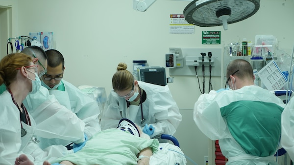 A trauma team examines a patient in the emergency department at Brooke Army Medical Center. BAMC has again been verified as a Level I trauma center by the American College of Surgeons.
