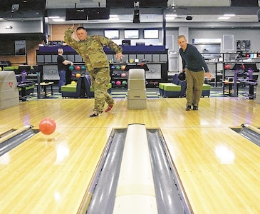 Staff Sgt. Michael Wadleigh, left, Headquarters and Headquarters Battalion, 1st Infantry Division, and Staff Sgt. Seth Bladen, right, 3rd Assault Helicopter Battalion, 1st Aviation Regiment, 1st Combat Aviation Brigade, 1st Inf. Div., warm up their throwing arms at the meet and greet Jan. 18.