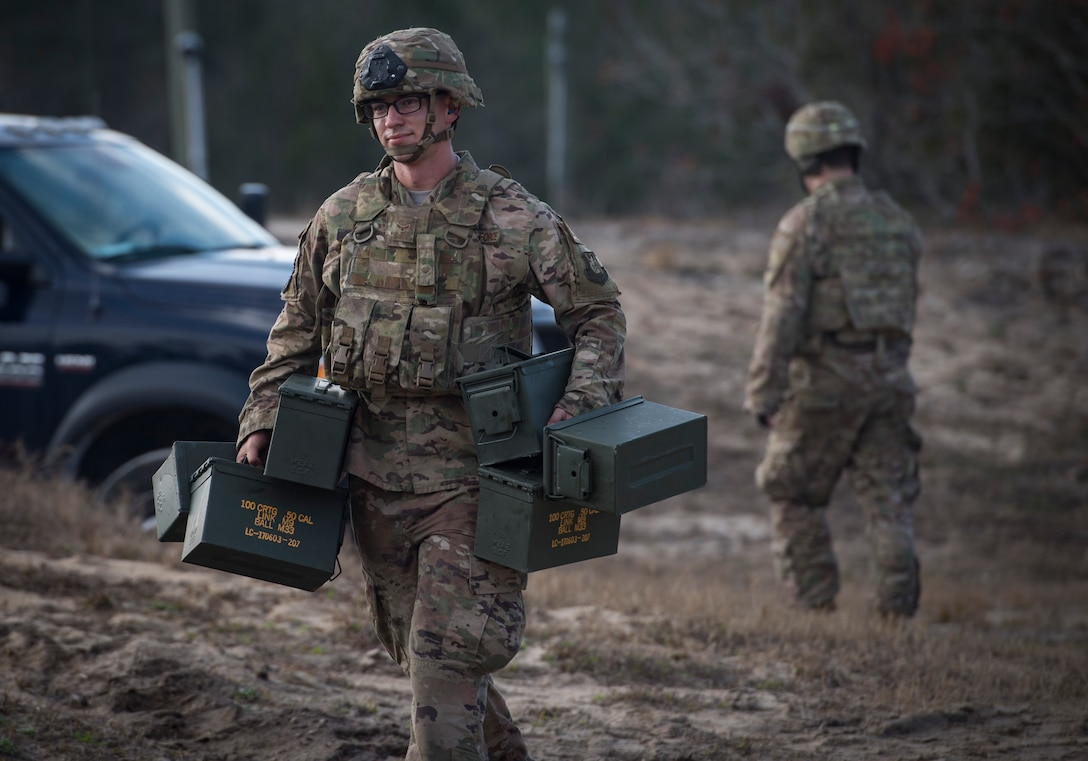 An Airman from the 824th Base Defense Squadron carries empty ammunition boxes during Weapons Week, Jan. 23, 2018, at Camp Blanding Joint Training Center, Fla. During Weapons Week, Airmen qualify on heavy weapons to include the M2 machine gun, Mark 19 40mm grenade machine gun, M240B machine gun, M249 light machine gun, M136E1 AT4-CS confined space light anti-armor weapon, and M18 Claymore mine. (U.S. Air Force photo by Senior Airman Janiqua P. Robinson)