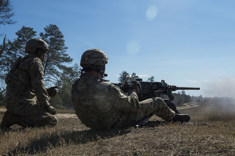 An Airman from the 824th Base Defense Squadron steadies himself while firing a M2 machine gun during Weapons Week, Jan. 23, 2018, at Camp Blanding Joint Training Center, Fla. During Weapons Week, Airmen qualify on heavy weapons to include the M2 machine gun, Mark 19 40mm grenade machine gun, M240B machine gun, M249 light machine gun, M136E1 AT4-CS confined space light anti-armor weapon, and M18 Claymore mine. (U.S. Air Force photo by Senior Airman Janiqua P. Robinson)