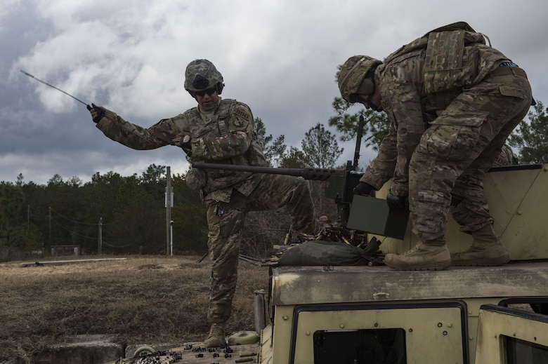Airmen from the 824th Base Defense Squadron ensure a M2 machine gun is clear during Weapons Week, Jan. 23, 2018, at Camp Blanding Joint Training Center, Fla. During Weapons Week, Airmen qualify on heavy weapons to include the M2 machine gun, Mark 19 40mm grenade machine gun, M240B machine gun, M249 light machine gun, M136E1 AT4-CS confined space light anti-armor weapon, and M18 Claymore mine. (U.S. Air Force photo by Senior Airman Janiqua P. Robinson)