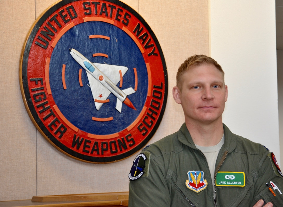 Capt. Jason Allenton, an air battle manager assigned to the 225th Air Defense Squadron, Western Air Defense Sector, is the second ever U.S. Air National Guardsman to graduate from the U.S. Navy Fighter Weapons School (TOPGUN) located at Naval Air Station Fallon, Nevada.  As a TOPGUN graduate, Allenton will share new techniques and best practices with his fellow Airmen and members of the Navy who come to train at the WADS from nearby installations in the Puget Sound.  (Courtesy photo)