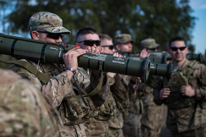 Airmen practice the firing procedures for an M136E1 AT4-CS confined space light anti-armor weapon, Jan. 24, 2018, at Camp Blanding Joint Training Center, Fla. During Weapons Week, Airmen qualify on heavy weapons to include the M2 machine gun, Mark 19 40mm grenade machine gun, M240B machine gun, M249 light machine gun, M136E1 AT4-CS confined space light anti-armor weapon, and M18 Claymore mine. (U.S. Air Force photo by Senior Airman Janiqua P. Robinson)