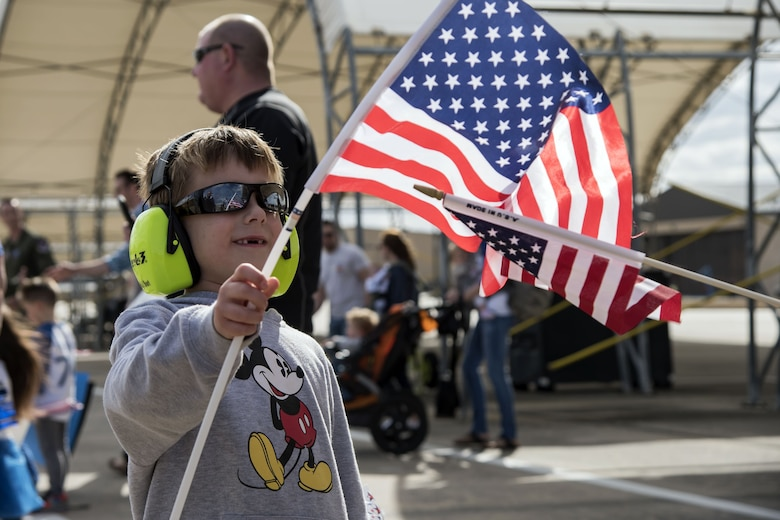 A child waves a flag during a redeployment of the 74th Fighter Squadron (FS) Jan. 26, 2018, at Moody Air Force Base, Ga. During the seven-month deployment the 74th FS flew more than 1,700 sorties, employed weapons more than 4,400 times, destroyed 2,300 targets and killed 2,800 insurgents. (U.S. Air Force photo by Airman Eugene Oliver)