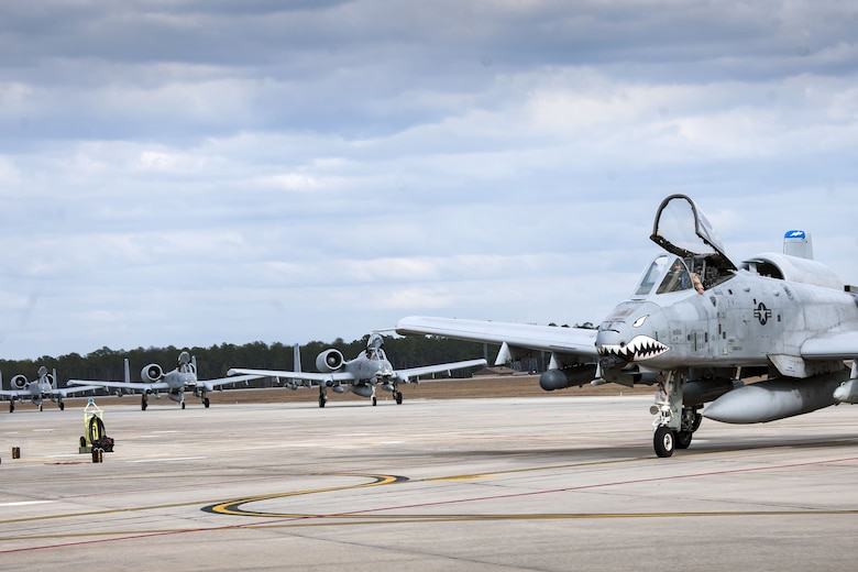 Four A-10C Thunderbolt IIs taxi toward their parking spots after returning from a deployment, Jan. 26, 2018, at Moody Air Force Base, Ga.  During the seven-month deployment the 74th FS flew more than 1,700 sorties, employed weapons more than 4,400 times, destroyed 2,300 targets and killed 2,800 insurgents. (U.S. Air Force photo by Airman Eugene Oliver)