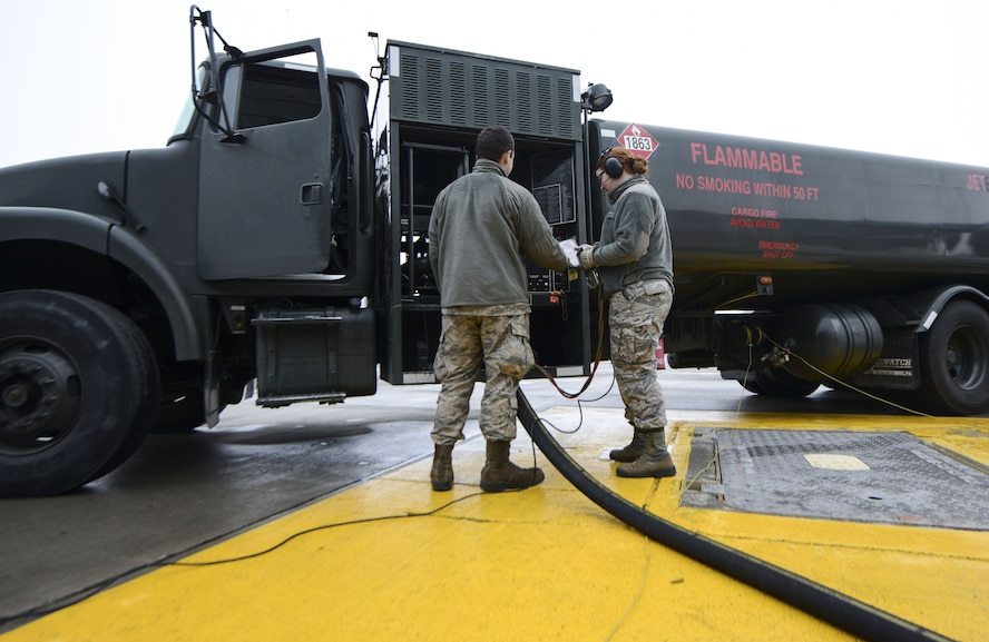 Airman 1st Class Nathan Hopkins trains Airman Britney Hogue how to defuel a KC-135 Stratotanker using an R-12 fuel truck. POL Airmen are responsible for providing optimal refueling support on and off the flight line. Both Hopkins and Hogue are 92nd Logistics Readiness Squadron fuels distribution operators. (U.S. Air Force photo/Senior Airman Janelle Patiño)