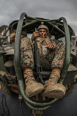 Private First Class Joshua Webb, with Alpha Battery,11th Marines, sits in the back seat of a M1163 Prime Mover as they load onto a Landing Craft Air Cushion as part of Iron Fist 2018, Jan. 19.